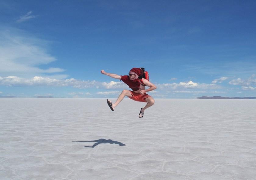 man-salar-de-uyuni-salt-flats-dry-hexigon-jump