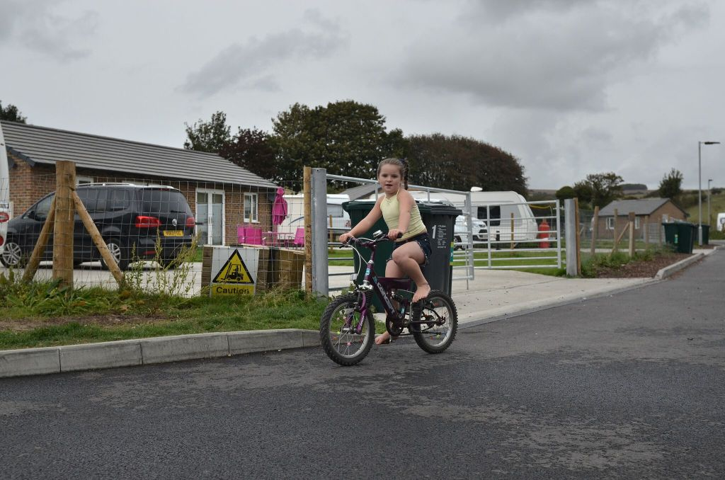 Picture of girl riding bike on a site