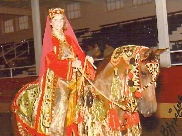 in Arabian costume on her Arabian horse