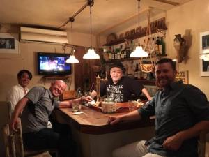 Grant and friends at a bar in Golden Gai Tokyo