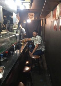 """Grant eating lunch in Omoide Yokocho """"Piss alley"""""""