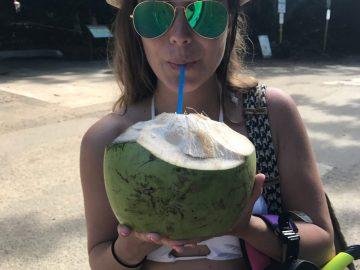 Rachel enjoying a coconut at Ke'e Beach in Ha'ena State Park
