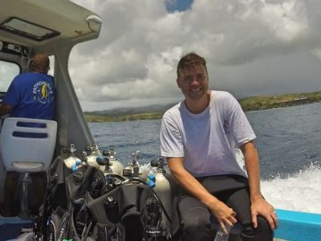 Grant on a dive boat in Kauai