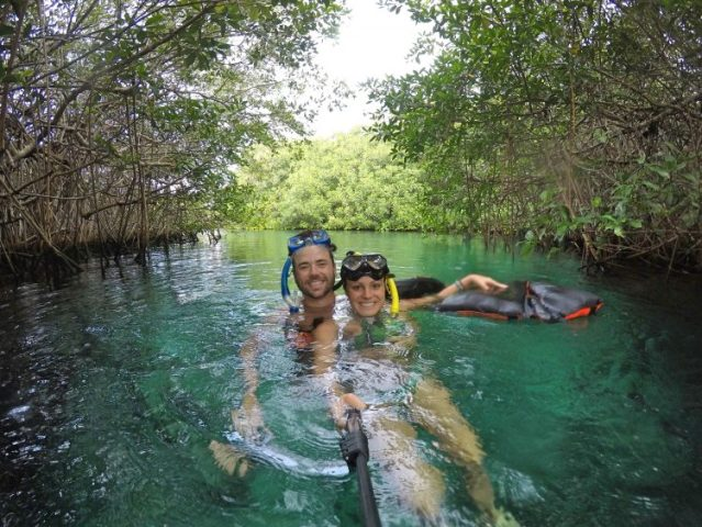 Grant and Rachel snorkeling in one of the best cenotes in Tulum