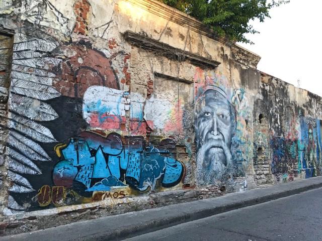 man's face street art in Cartagena