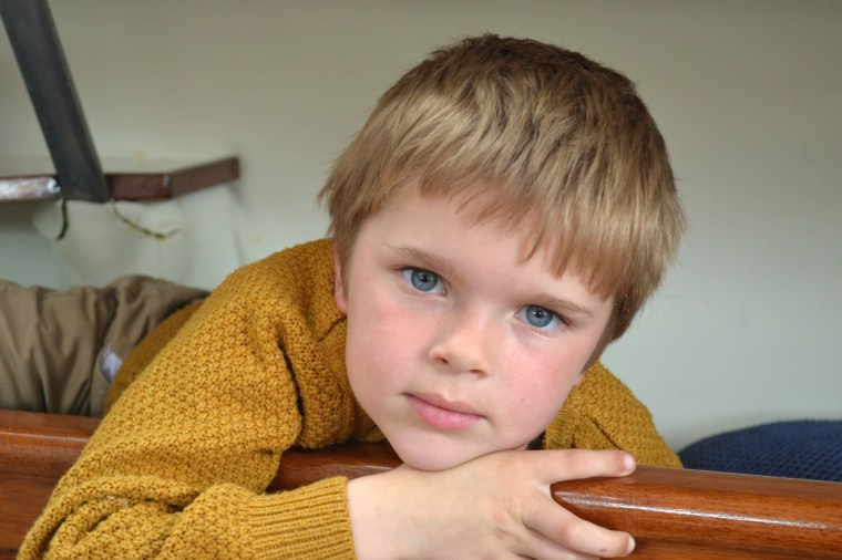 Our son on our boat, having a rest in one of the bunks