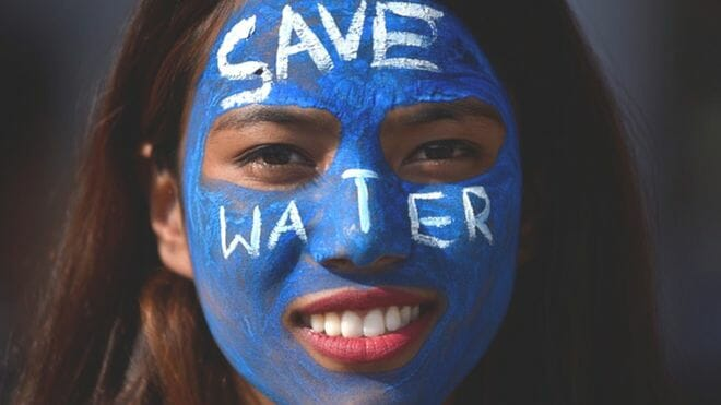 photo: face paint with words Save Water. How to eat well - and save the planet