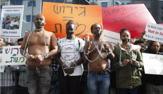 Asylum seekers protest Israel's policy of deportation to Rwanda in front of the Rwandan embassy in Herzliya on January 22, 2018.