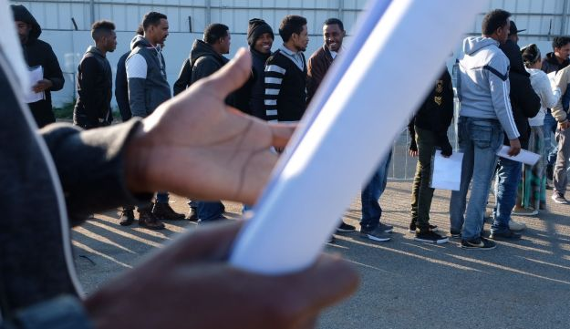 Asylum seekers standing in line to renew their visa at the Interior Ministry in Bnei Brak, February 1, 2018.