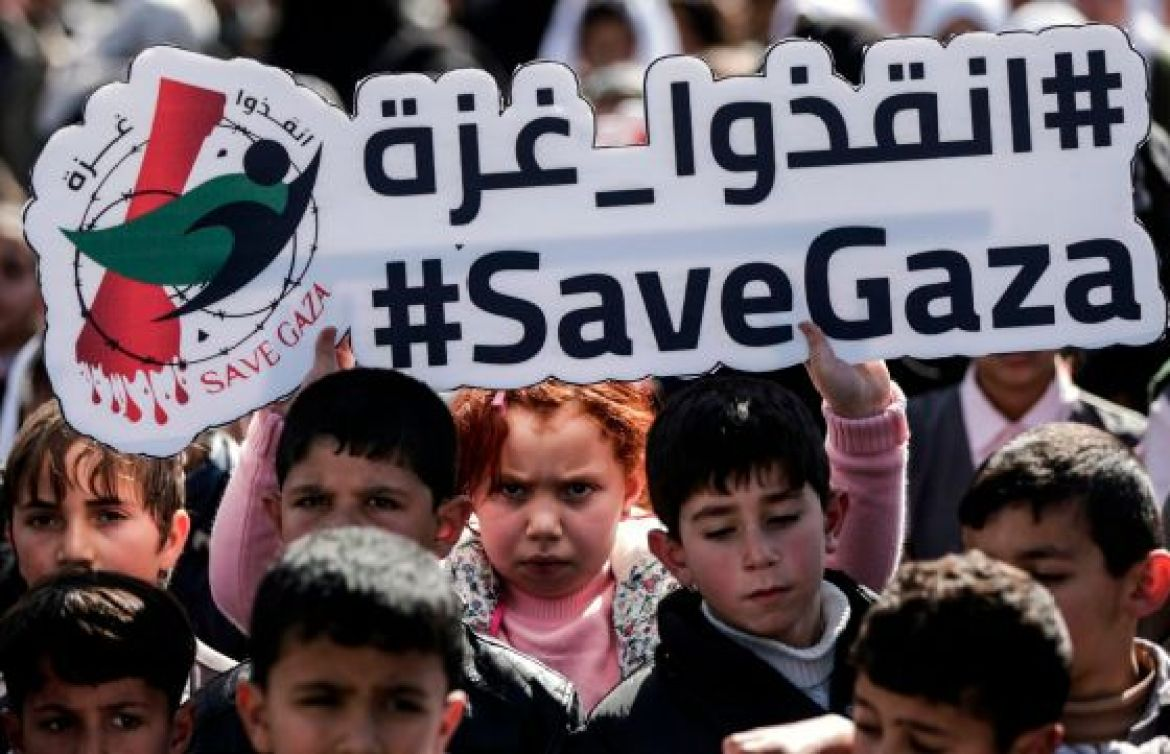 Palestinian schoolchildren shout slogans and hold placards during a protest in Gaza city on February 4, 2018, against the difficult economic situation.
