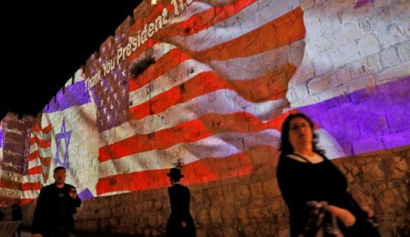 Israeli and American flags are projected on the walls of the ramparts of Jerusalem's Old City to mark the opening of the new U.S. embassy, May 14, 2018.