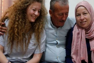 Palestinian teen Ahed Tamimi sits with her parents in their home in the West Bank after being released from Israeli prison, July 30, 2018.