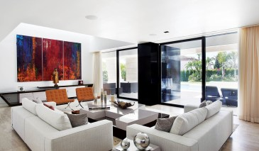 Dramatic artworks form focal points for essentially contemporary furniture.