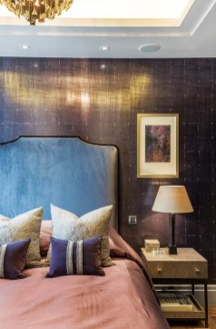 30 - The girl's bedroom features a softer palette of plums, purples, soft blues and greys