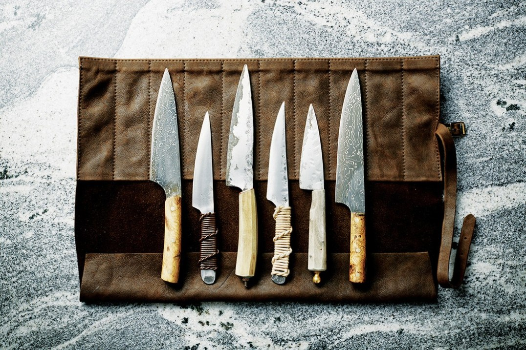 Knives all by The Tool Room: small kitchen knife, Damascus wooden handled large knife, hand forged boning knife with thong handle.