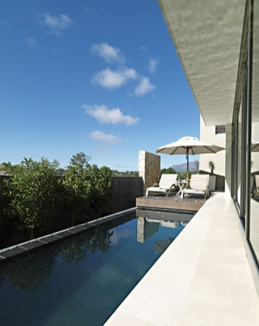 The fall of land on this picturesque site encouraged rectangular contemporary architecture and ingenious use of space.