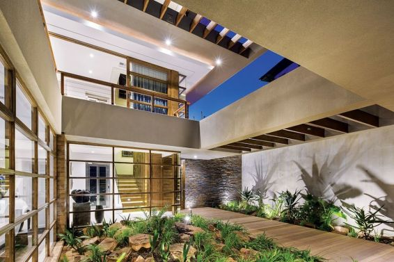 The double volume courtyard, positioned centrally at the core of the home, acts as a hub that the other spaces radiate from.