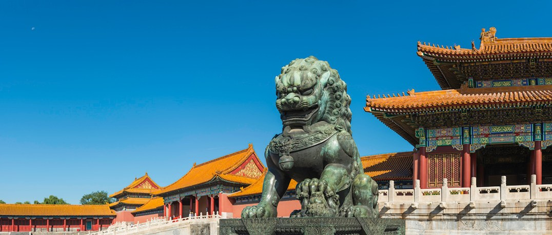 Bronze Imperial Lion guarding the marble steps to the Gate of Supreme Harmony in the Forbidden City, the UNESCO World Heritage Site in the heart of historic Beijing, China's vibrant capital city.