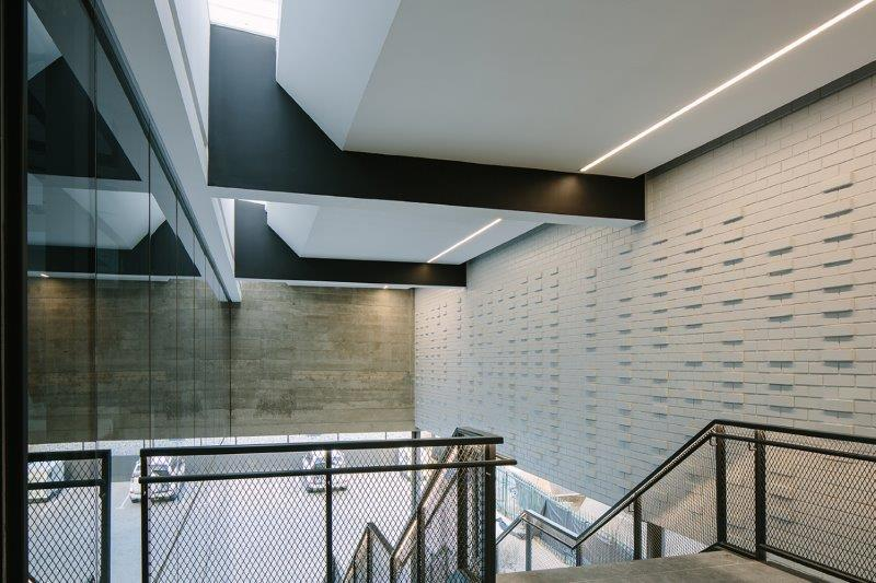 Opaque polycarbonate skylights let light into the foyer