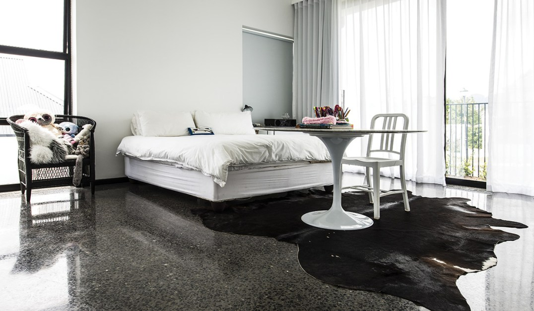 Pristine flooring is a foil for this white bedroom suite. Space and light emphasise the elegant modernism.