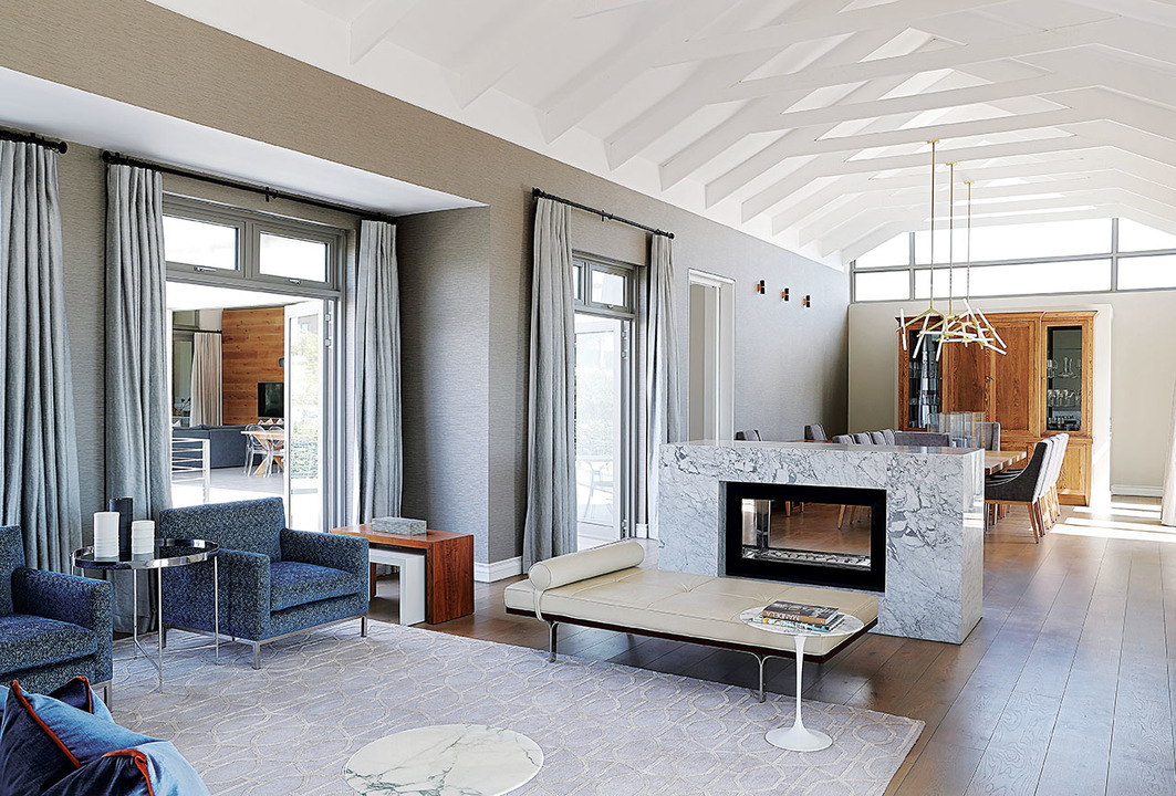 The interior volumes are generous and made more so with a pale palette of neutrals, low profile seating and uncluttered walls.