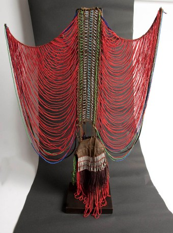 Kezhia Orege A female Dinka corset Sudan mid-20th century 28 cm high x 18 cm wide £2,500 Stunning rare beaded female necklace/bodice from the Dinka tribe, the intricate complex bead work encapsulates the essence of their stylish, romantic tradition as the beads are worn by young females symbolising their eligibility for marriage. The design, style, colour and materials used are all attributes of wealth, status and age. The bodice is made of different coloured glass beads, fibre and cotton textile.