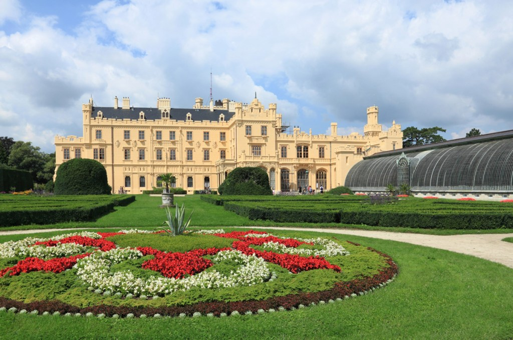 manicured garden in front of a stately castle