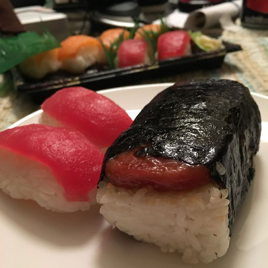 Spam musubi and sushi on a plate