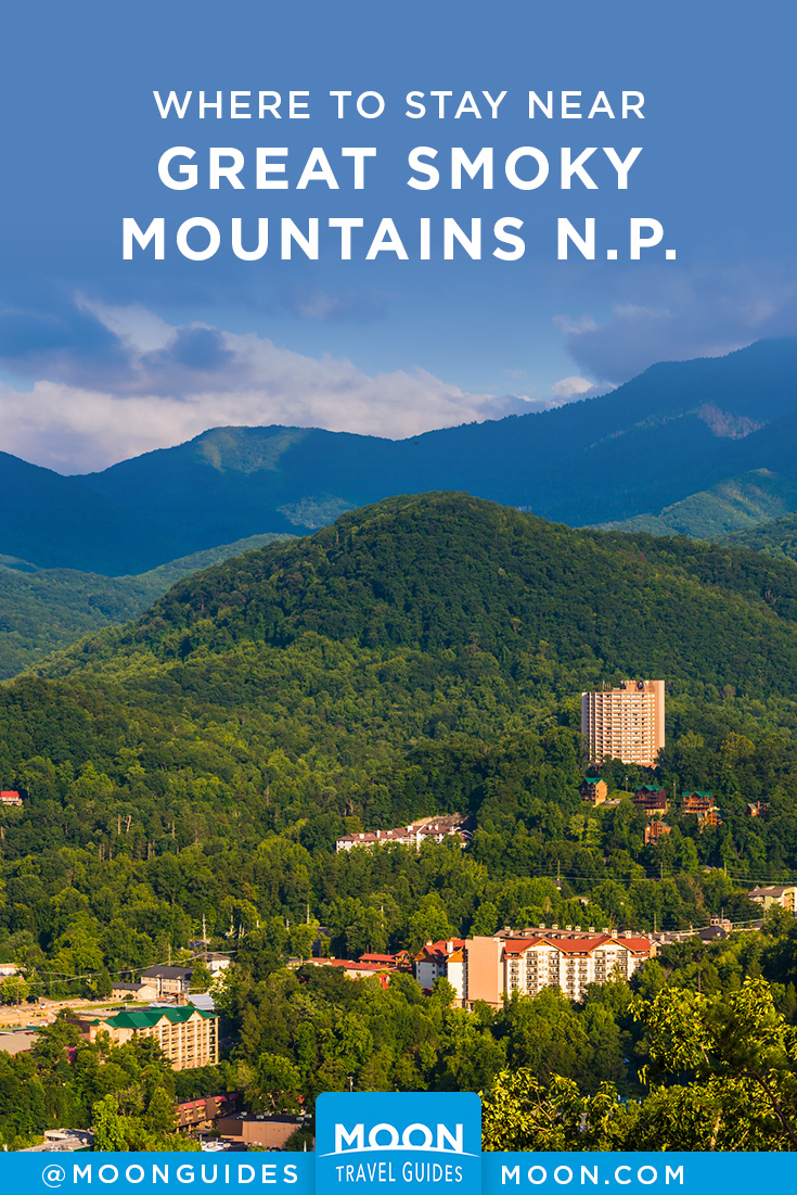 landscape view of gatlinburg with overlaid text reading where to stay near great smoky mountain national park