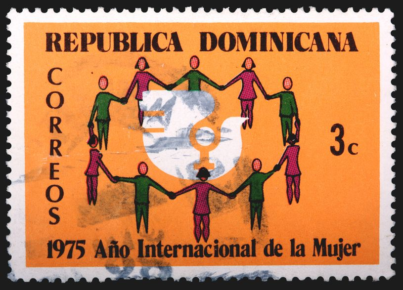 Photo of vintage RD stamp with artwork of women holding hands in a circle.