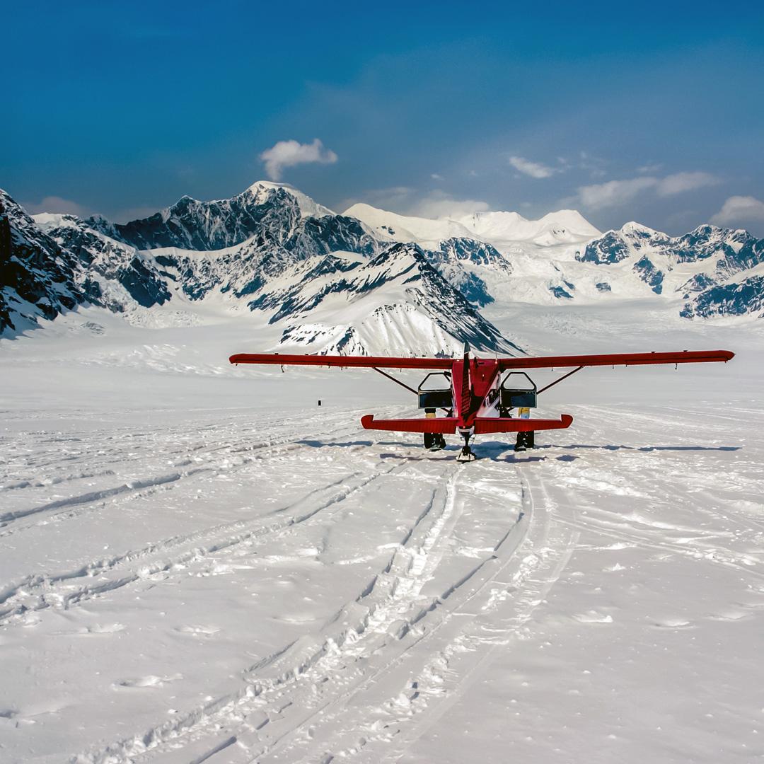 ec590b8c red airplane on Ruth Glacier