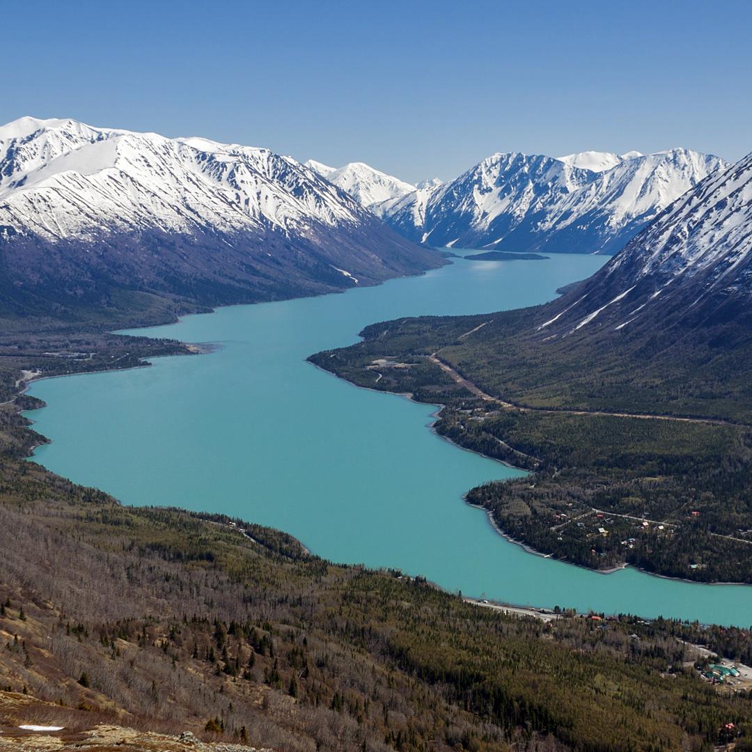 kenai river snaking through the mountains in alaska