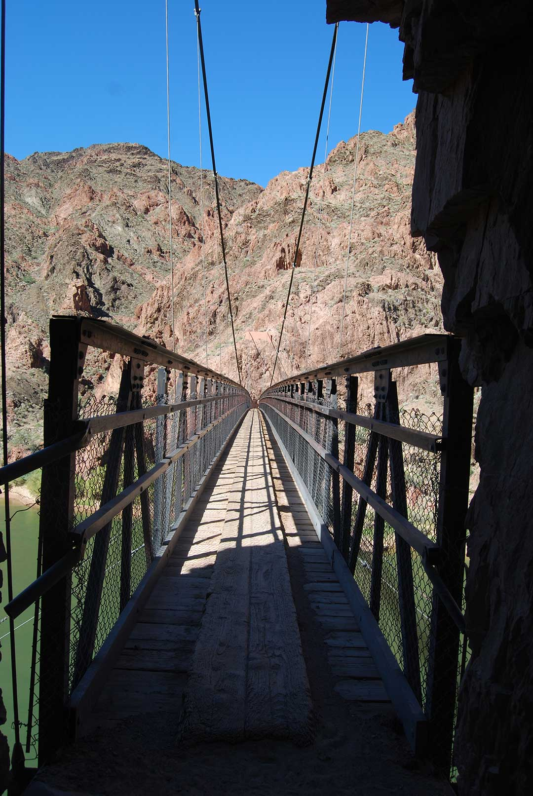 A hanging bridge over the Colorado River in Arizona's Grand Canyon. Photo © Tim Hull.