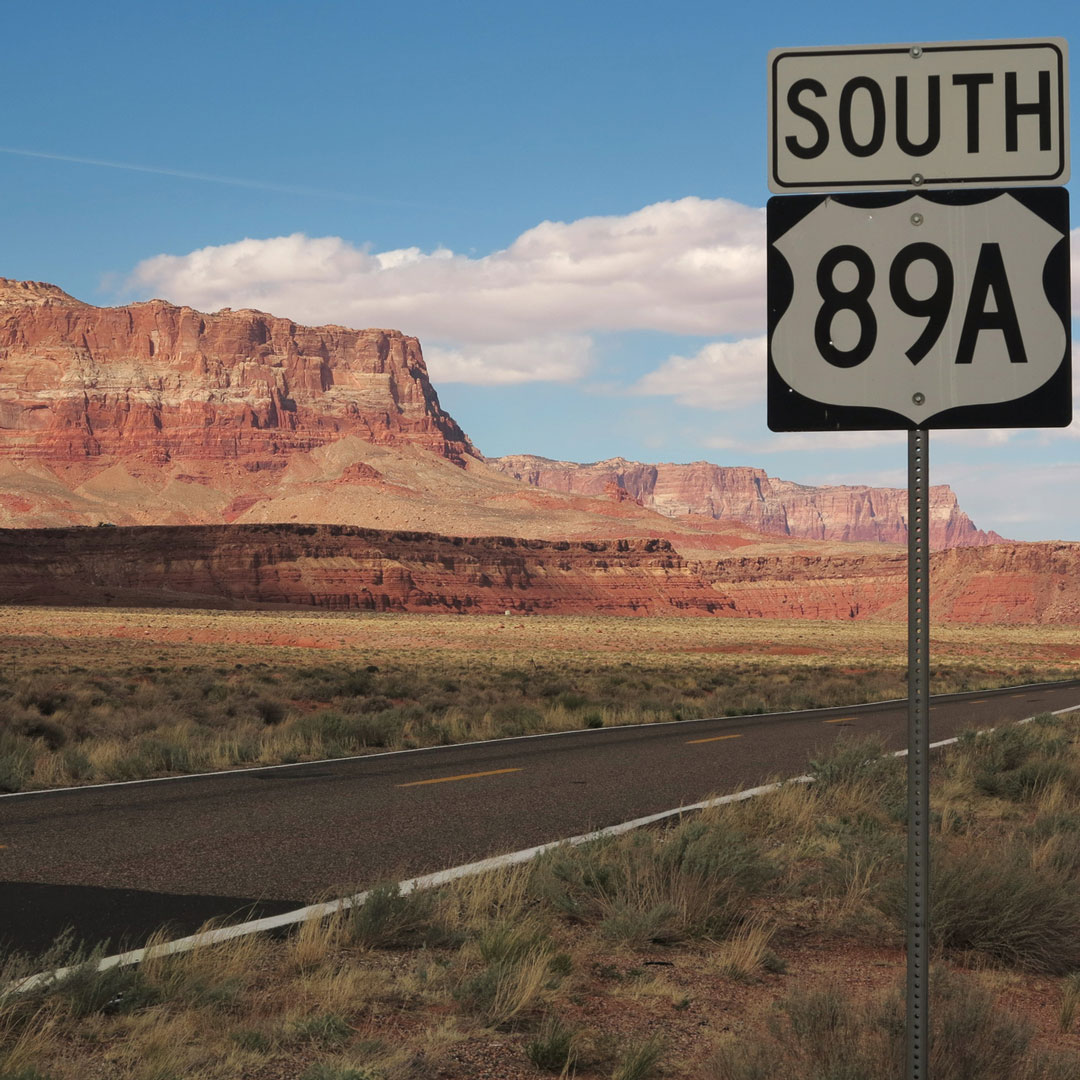 Highway 89a South sign with a view of the Vermilion Cliffs in Arizona
