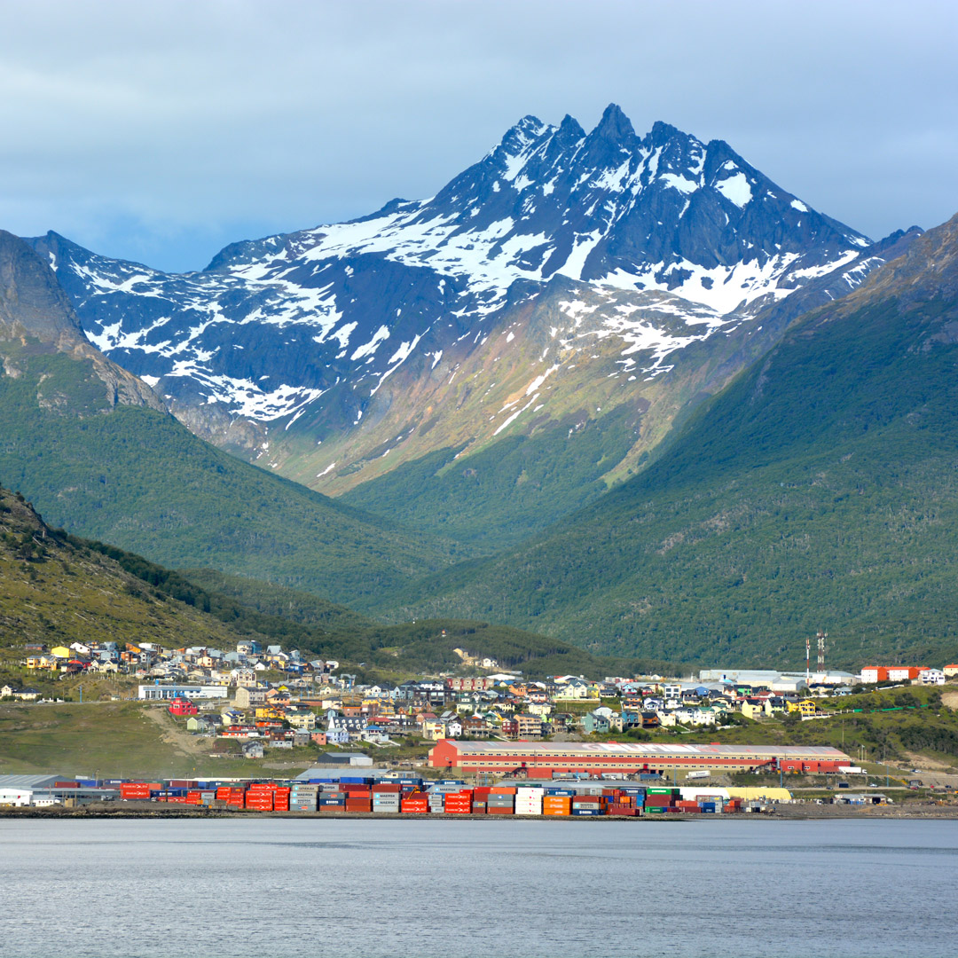 lakeside town of Ushuaia backed by the spires of Tierra del Fuego in Argentina