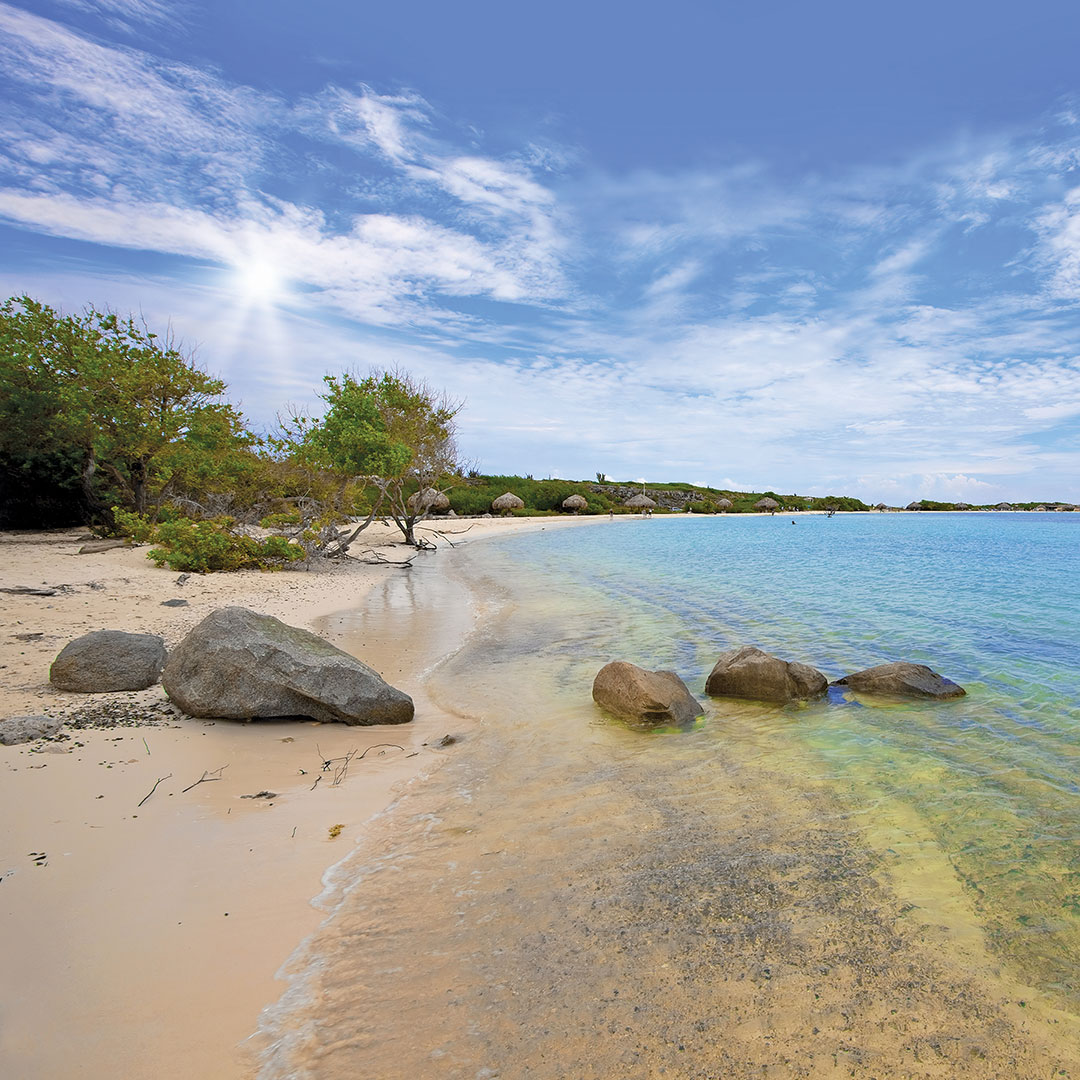 sun shining on Baby Beach in Aruba