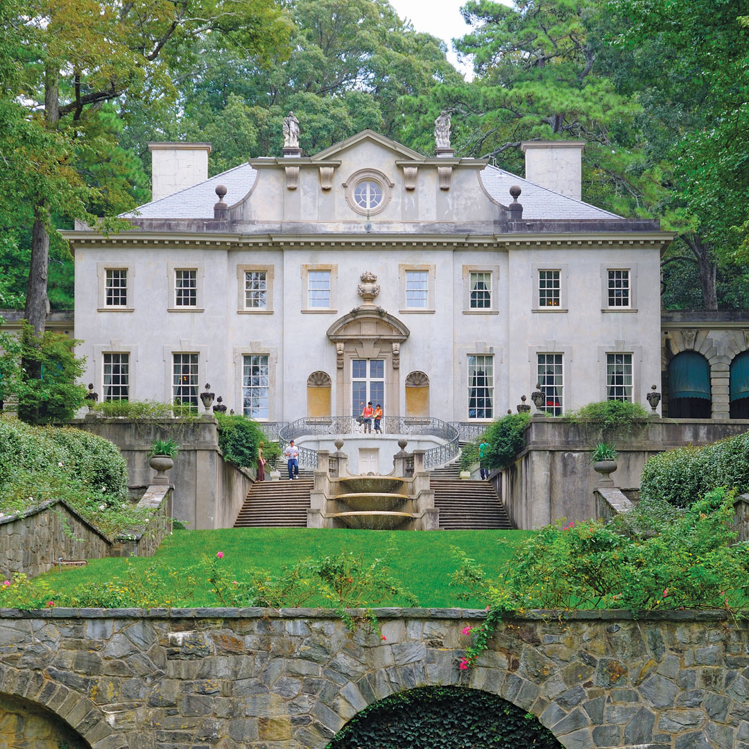 historic swan house mansion surrounded by trees