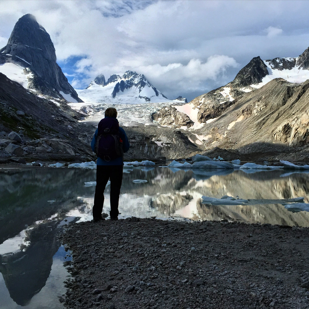 hiker standing near a lake in the Bugaboos of British Columbia