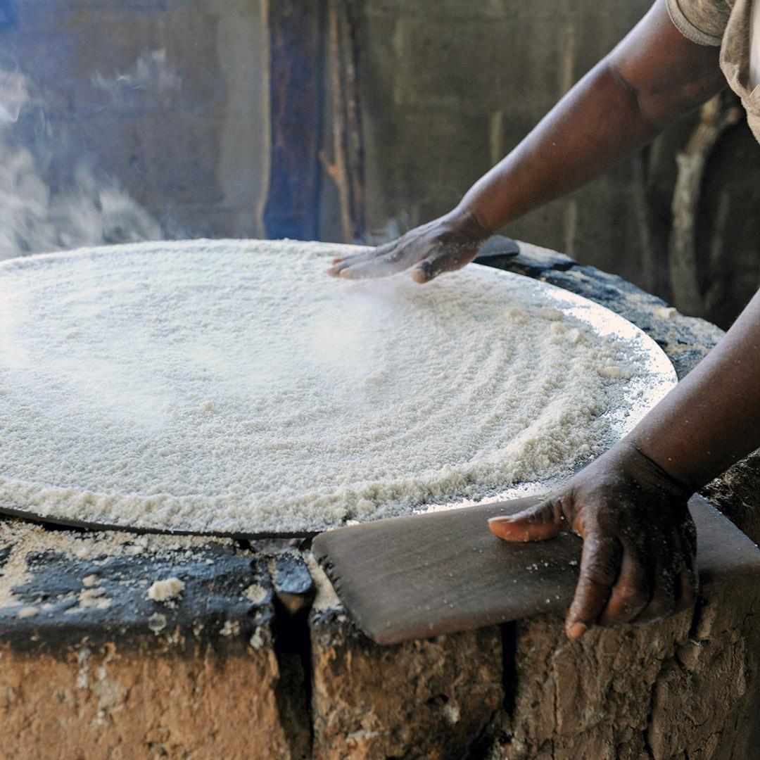 Belizean woman cooking cassava bread