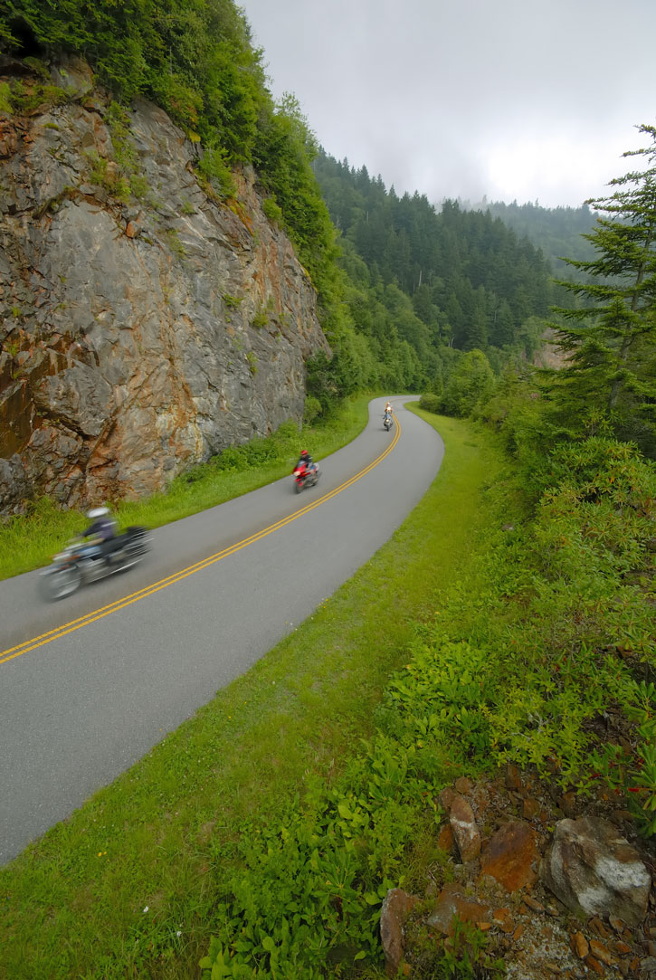 A trio of motorcycles along an S-curve on the Blue Ridge Parkway.
