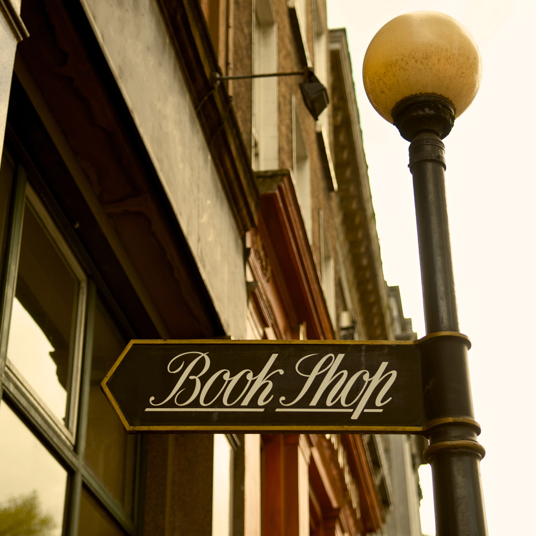 old fashioned book shop sign on a street lamp