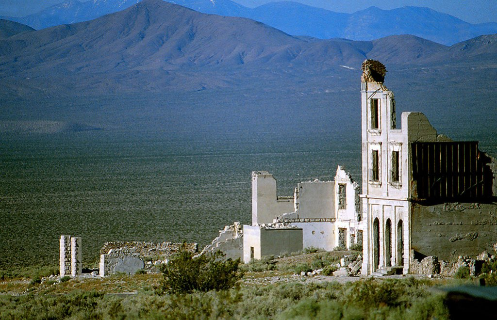 Partial walls stand as remnants of Rhyolite, Nevada, a ghost town near Death Valley National Park.
