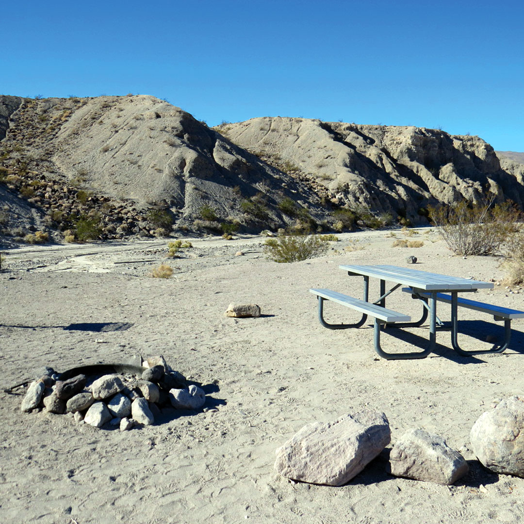 picnic table and campfire in a Mesquite Spring campground in Death Valley