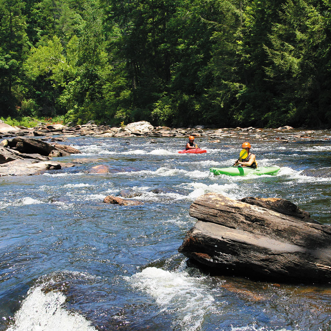 two people in canoes on the Chattooga River