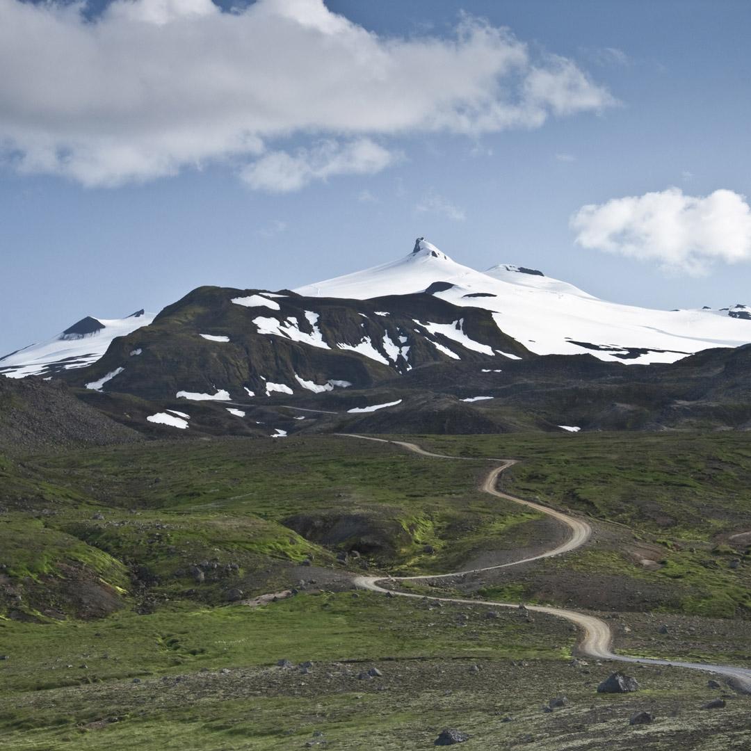 a path winds toward snaefellsjokul glacier in Iceland