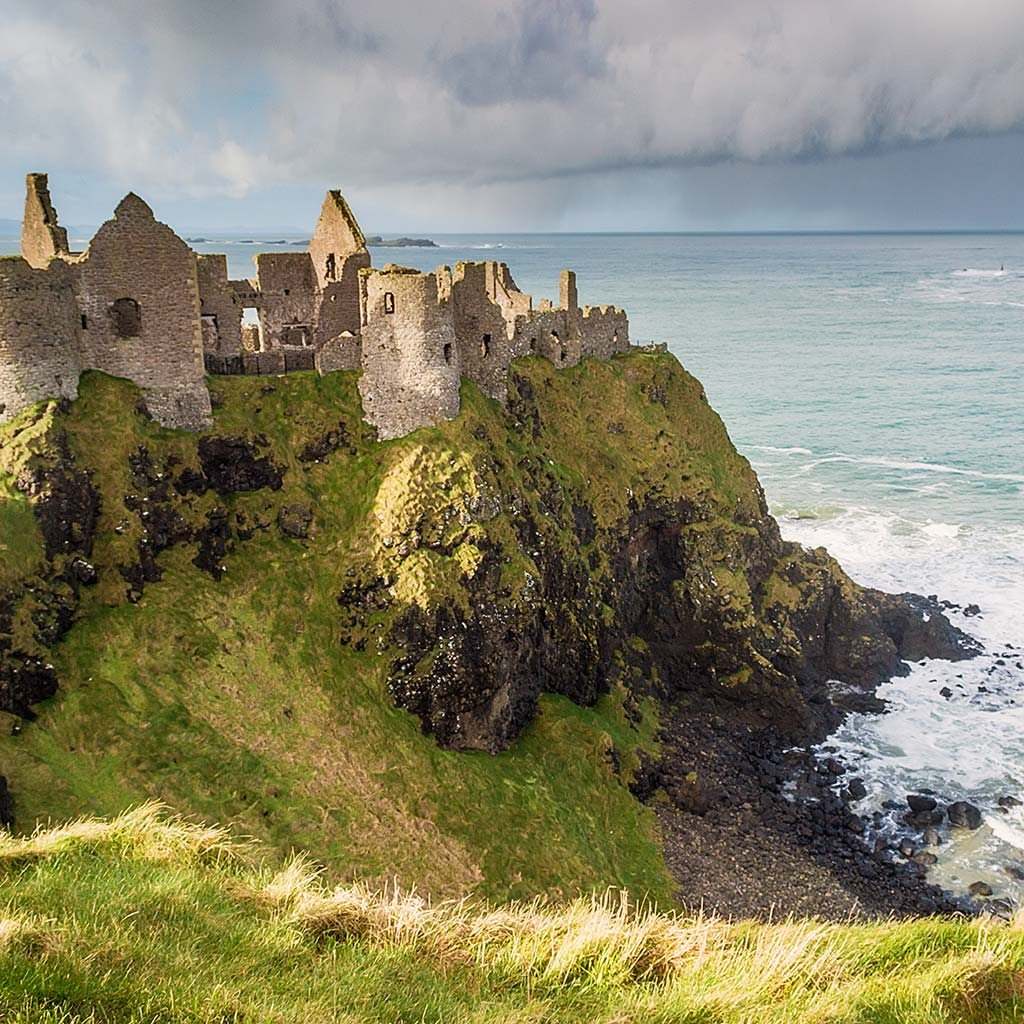 Seaside Dunluce Castle perches precipitously on a basalt cliff.