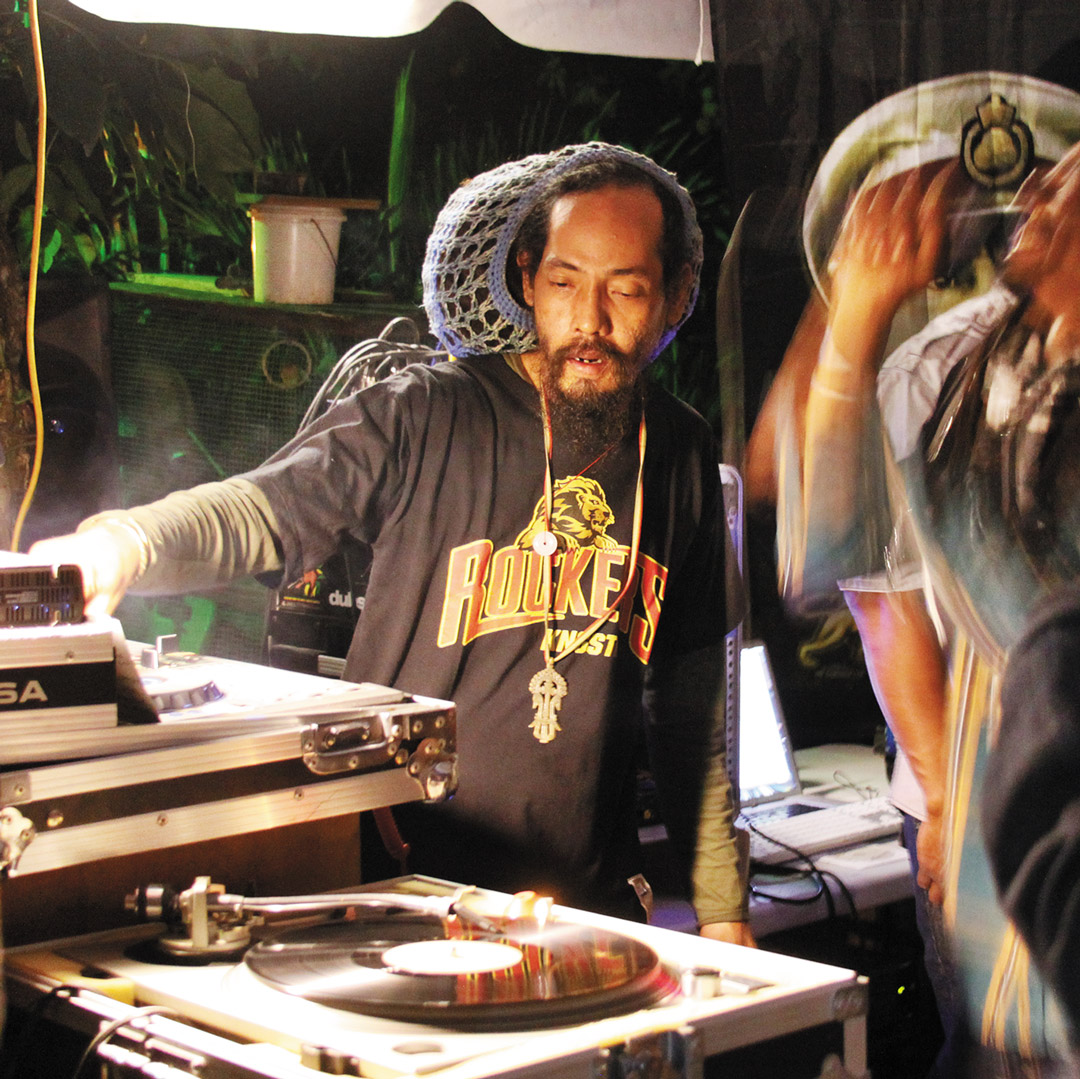 dj spinning at a club in Kingston Jamaica