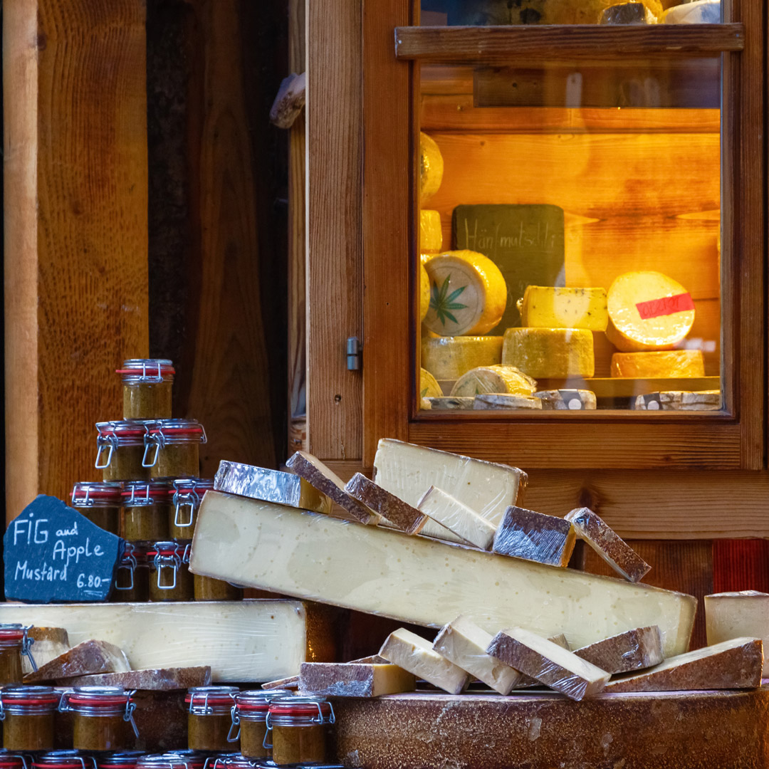 a variety of cheeses on display at the Borough Market in London