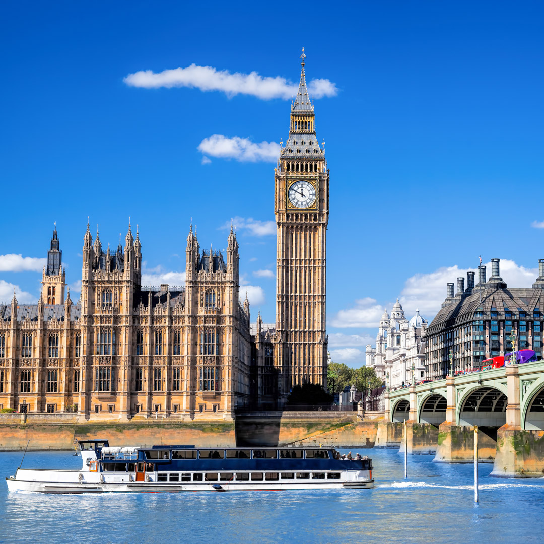 ferry boat in the River Thames in front of the Houses of Parliament, London