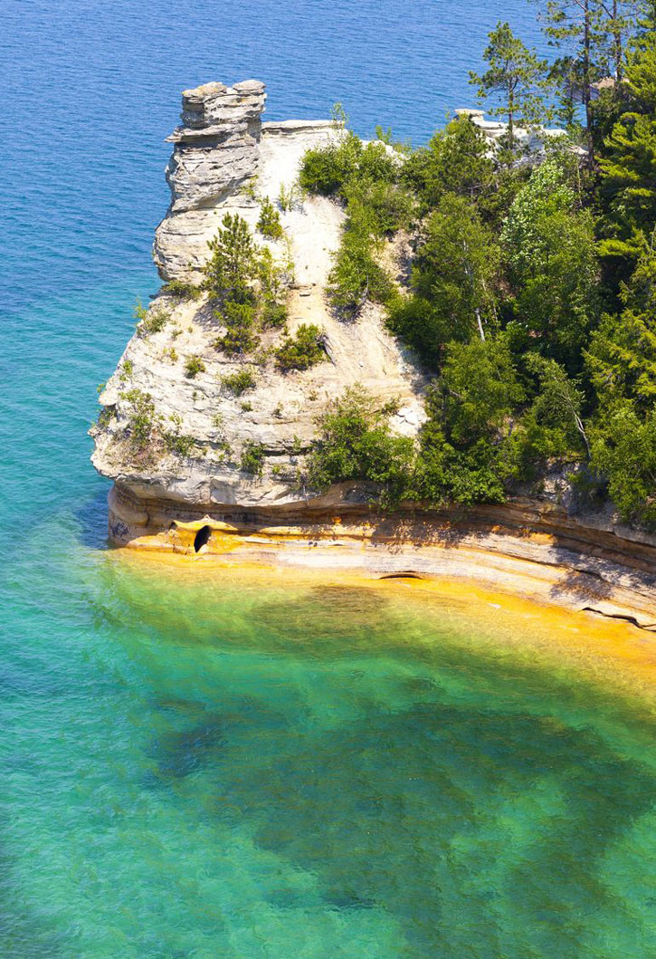 Turquoise water at the shore at Pictured Rocks National Lakeshore.